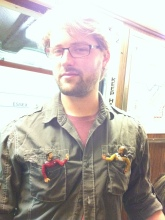 Chris and his birthday action figures on the T.
