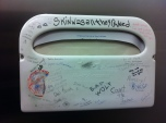 A toilet cover holder in the Powell's Books women's room graffiti-ed with Doctor Who quotes.